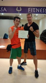 Certified Kickboxing Instructor in 2015 by IFTA. Photo with Greg Sims (Director of Operations)